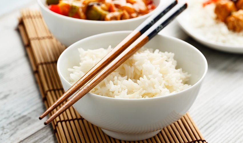 Eating rice with chopsticks