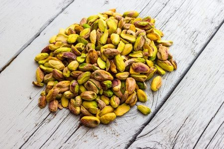 Pistachios on a wooden board