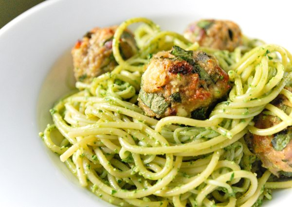 Spaghetti with spinach meatballs in a plate