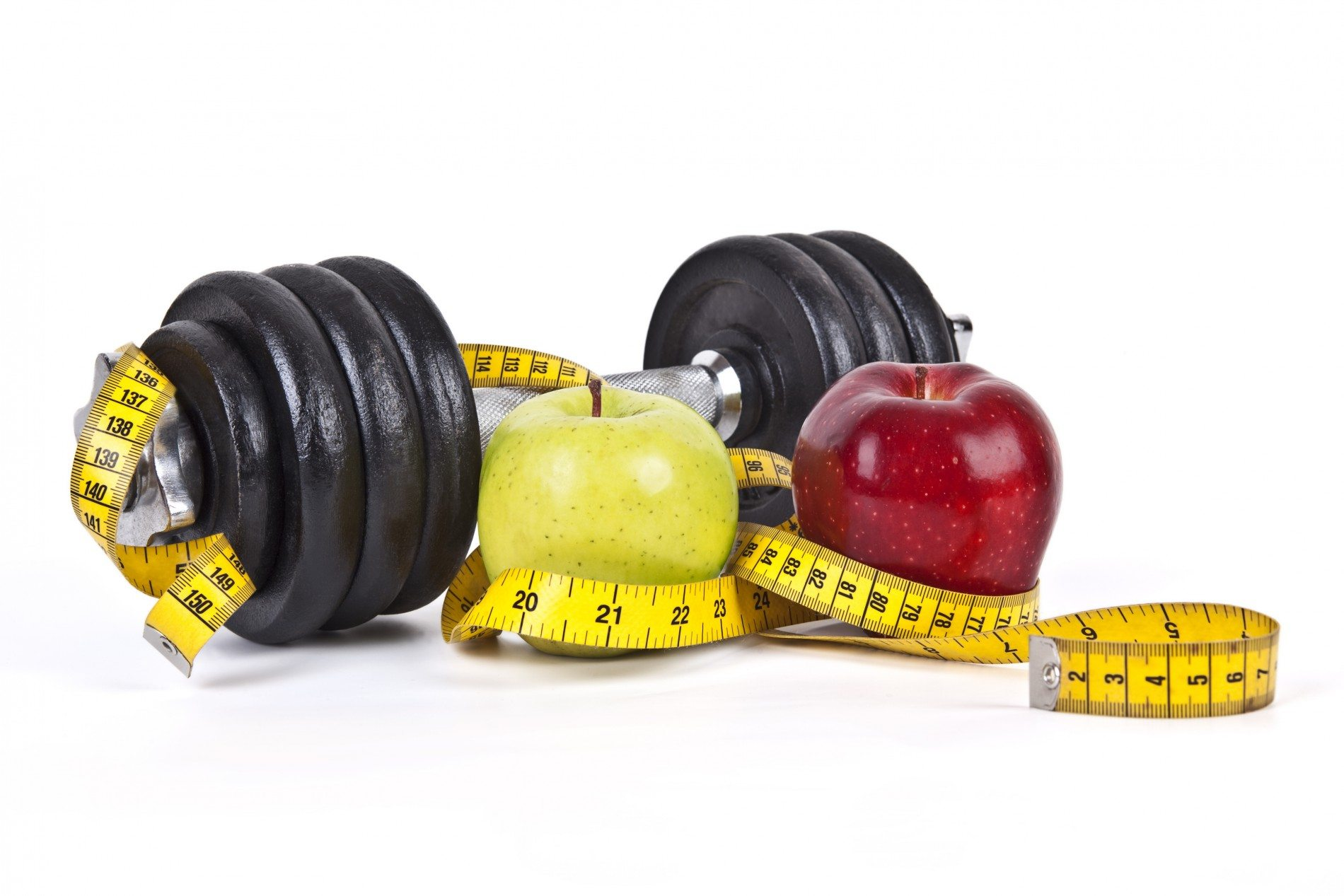 A dumbbell, two apples and a tape measure
