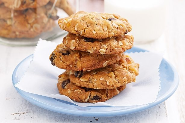 Five oat cookies on a plate