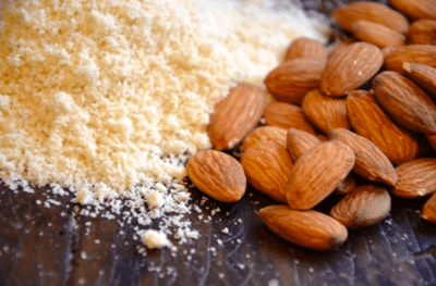 Almonds and almond flour on a table