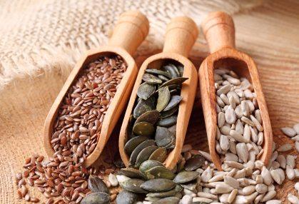 Seeds in wooden scoops