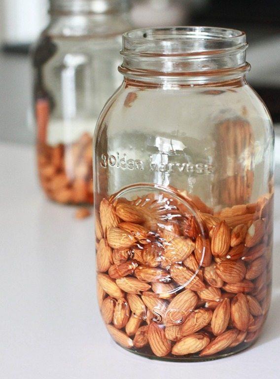 Nuts soaking in a glass jar