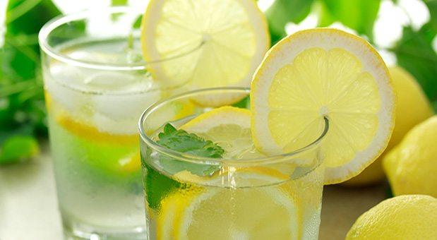 a glass of fresh lemon water