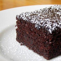 A sliceof vegan chocolate cake on a plate