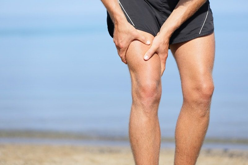 a runner suffering from muscle cramps