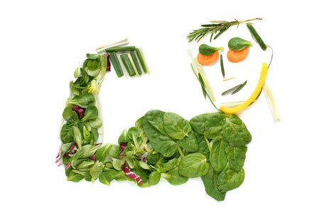 a figure of an athlete made from vegetables