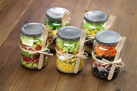 several tasty meals in jars