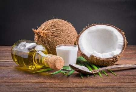coconuts and coconut oil on a table